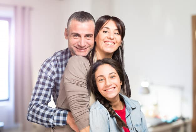 parents with daughter happy
